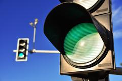 Traffic lights over blue sky. Green light Stock Photos