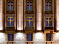 Windows on night facade of Hotel Astoria Stock Photos