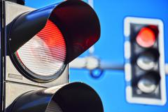 Traffic lights over blue sky. Red light Stock Photos