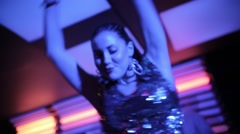 Three girl in sexy shiny dress dancing in front of an audience on stage at night Stock Footage