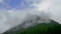 Green Hills and Mountains with Rising Clouds Timelapse. Kavkaz region Stock Footage