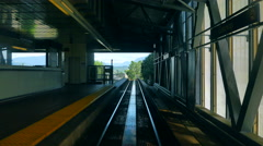 4K Skytrain Subway Train Station, Train Passes Platform, Comes to Stop Stock Footage