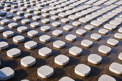 Many concrete tiles in water Stock Photos