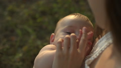 Young mum holds on hands her little baby Stock Footage