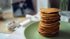 Jam pouring on pancake stack. Strawberry jam on stack of golden pancake Stock Footage