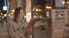Reading News on Tablet - stock footage