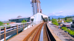 4K Above Ground Train Arrives at Station Platform Stock Footage