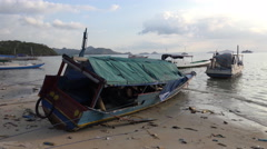 4k Human pollution trash and primitive fisherman boats at dirty beach - stock footage