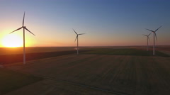 Aerial view of cluster of wind turbines in rural agriculture field. Stock Footage