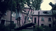 The ghost of a little girl on a swing in the old ruined house. evil spirit Stock Footage