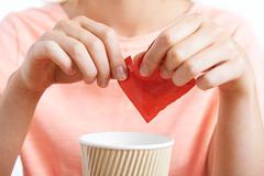 Woman Adding Artificial Sweetener To Coffee Stock Photos