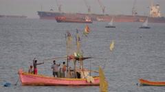 Fisherman preparing net in harbour,Mumbai,India Stock Footage