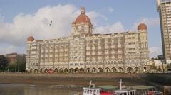 Taj Mahal Palace hotel on harbour,Mumbai,India Stock Footage