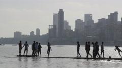 Kids playing on chowpatty beach,Mumbai,India Stock Footage