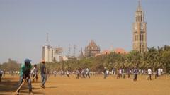 Men playing cricket on Oval Maidan,Mumbai,India Stock Footage