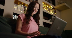 4k, Young attractive woman working on her laptop at night. Stock Footage