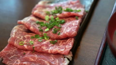 Beef sliced meat for Japanese shabu hot pot Asian style. Stock Footage