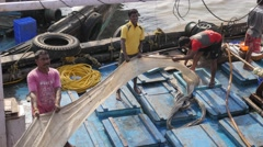 Filling crushed ice in fishing boat,Mumbai,India Stock Footage