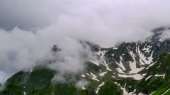 High Snowy Mountains with Clouds Timelapse on Overcast Days. Kavkaz region Stock Footage