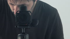 Man behind camera directing and recording scene Stock Footage