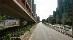Tin Shui Wai, Hong Kong- July 2016: Driving through city streets time lapse i Stock Footage