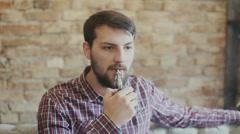 Man smoking electronic cigarette vapor - stock footage