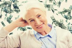 happy senior woman face over violet background - stock photo