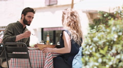 Young couple eating alfresco - stock footage