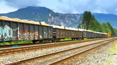 4K Train Box Cars Sitting on Railway Track Siding, Mountains in Background Stock Footage