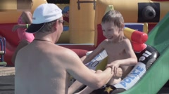A man with a child frolic in the water in the pool,slow motion Stock Footage