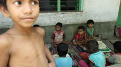 Village children students in India stand and recite for learning Stock Footage