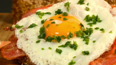 Extreme zoom anddolly around brown bread with ham and fried egg Stock Footage