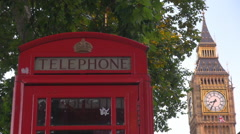 Big Ben famous icon in London red retro telephone cabin and Elizabeth Tower icon Stock Footage