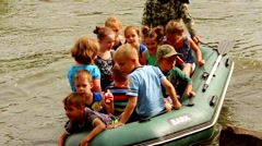 Kids playing on the inflatable boat Stock Footage