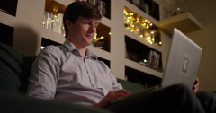 4k, Young attractive man working on her laptop at night. Stock Footage