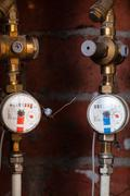 Hot and cold mechanical water meters Stock Photos