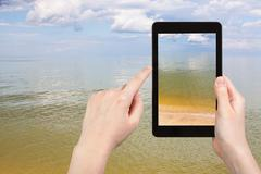 Calm surface of Azov Sea on tablet pc Stock Photos