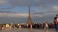 Timelapse tourist people enjoy take photo to Eiffel Tower in Paris famous emblem Stock Footage