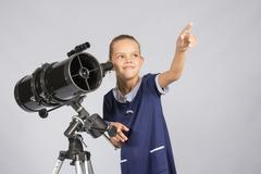 The young astronomer pointing at the starry sky Stock Photos