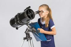 The young astronomer happy to look through the telescope recording observatio Stock Photos