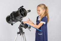 Astronomer happily looks at records with observations Stock Photos