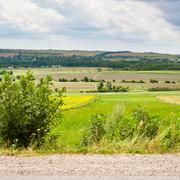 Country landscape with road, fields and village Stock Photos