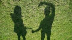 Shadows make a heart over grass Stock Footage
