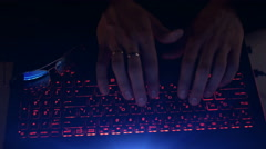 Hacker using laptop. Lots of digits on the computer screen Stock Footage