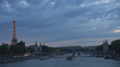 Amazing view to illuminated Eiffel Tower and Alexander Bridge in Paris twilight Stock Footage