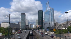 Timelapse traffic car and metro train pass to La Defense business district Paris Stock Footage
