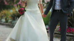 Beautiful wedding couple walks and holds hands close up. Como, Italy Stock Footage