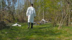 The man walk through the wood near the midden Stock Footage