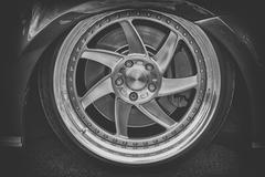 Close-up of aluminium rim of luxury car wheel Stock Photos