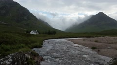 Timelapse of clouds moving over glencoe on a summer day in scotland Stock Footage